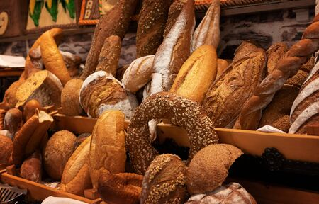 Assortment of fresh baked bread and bread slices