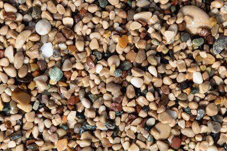 Small color sea pebbles background, close up Reklamní fotografie