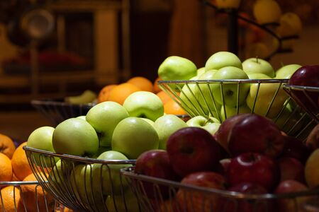 Green and red apples in a fruit bowl.