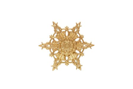 Golden snowflake isolated on the white background Reklamní fotografie