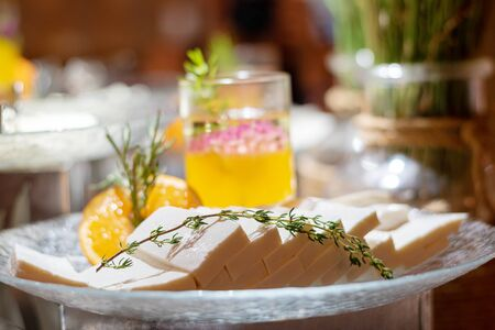 Cutting feta cheese with thyme as a decoration Reklamní fotografie