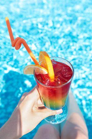 Refreshing cocktail near swimming pool, close up. Stockfoto