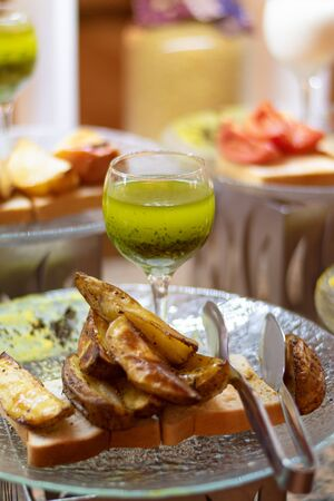 Baked potatoes served with green herb sauce. Stok Fotoğraf
