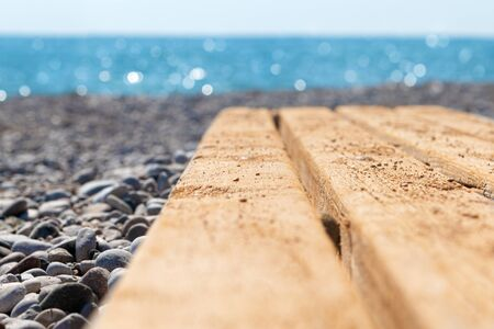 Empty Wooden desk on the beach background.