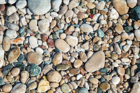 Small color sea pebbles background, close up 写真素材