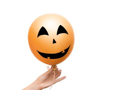 Decorative orange balloon for Halloween party on white background