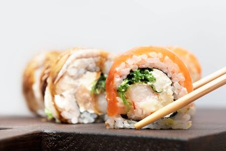 Homemade Sushi roll with salmon and cream cheese.
