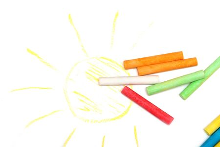 Colored crayons on a white sheet of paper 写真素材