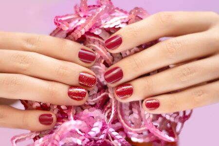 Female hand with pink glitter nail design. 写真素材