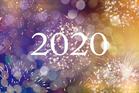 Happy new year 2020 written with Sparkle fireworks and bokeh