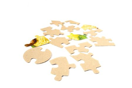 Pieces of cardboard puzzles isolated on white background