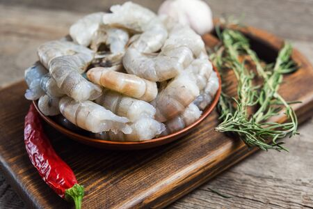 Close up of raw shrimps on wooden background
