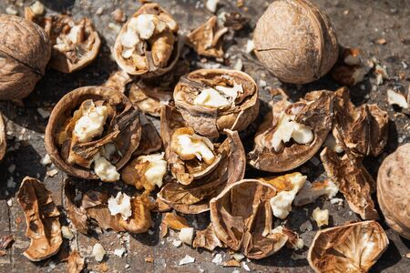 Chopped walnut on a wooden chopping board. Stok Fotoğraf