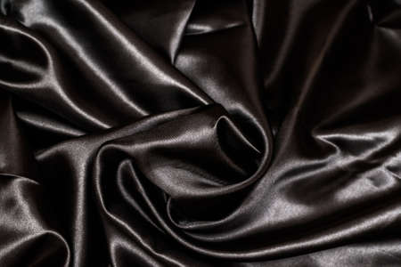 Shiny black fabric. Black wavy fabric background 免版税图像