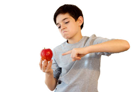 kid pointing: Kid pointing an Apple. Cute caucasian boy pointing an apple. Isolated on white. Stock Photo