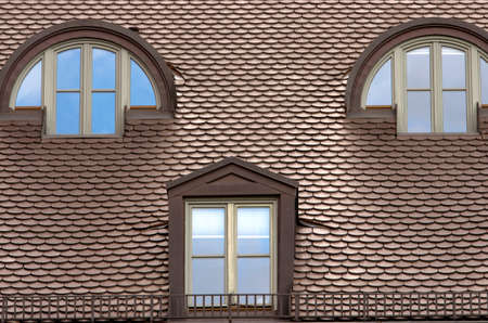 roof windows: Tiled roof.Tiled sloped roof with windows. Classical german architecture. Munich,Bavaria,Germany Stock Photo