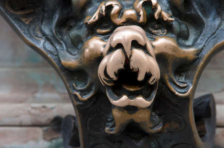 residenz: Cast iron dog s head relief decoration in Residence palase. Munich, Bavaria,Germany