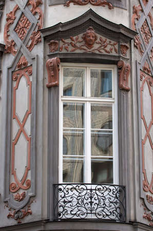 cast in place: Balcony window.Balcony from cast iron and ornamented facade with relieves.Classical german architecture. Munich,Bavaria,Germany
