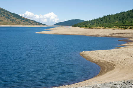during: Bulgarian mountain lake during drought Stock Photo