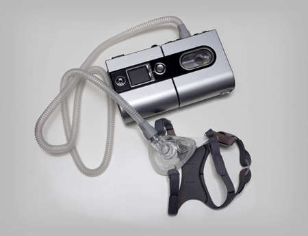 snore: Cpap machine and mask for a sleep apnea isolated image. Stock Photo