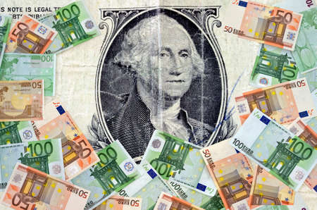 devaluation: Dollar and Euro concept.United States Dollar bill and Euro banknotes as a concept of exchange rate and devaluation. Stock Photo