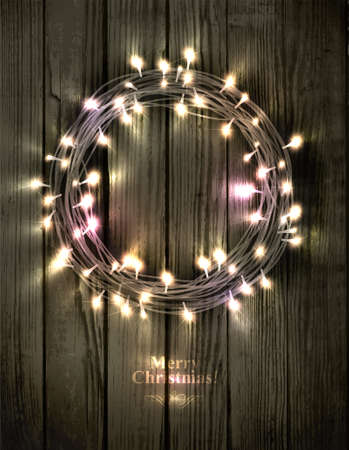 Glowing Christmas wreath made of led lights on the wooden