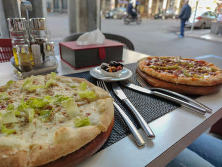 Delicious pizza on a table outside a restaurant