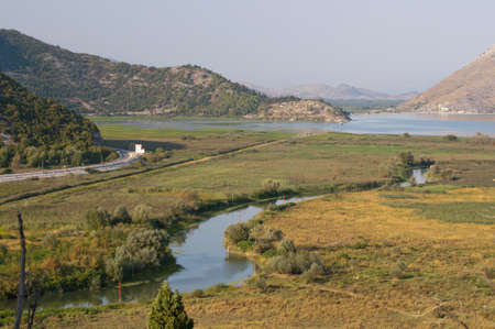 River flows through fields to Skadar lake in Montenegro  Virpazar town  There is highway from Bar to Podgorica in the left side of image Stock Photo - 16324161