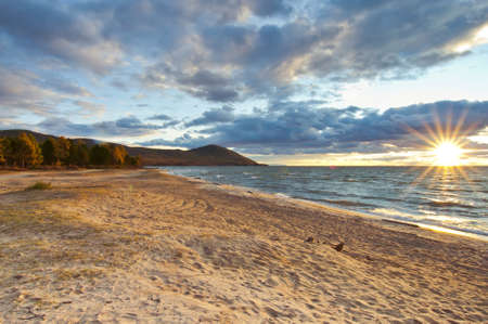 Sunset on Baikal sandy beach photo