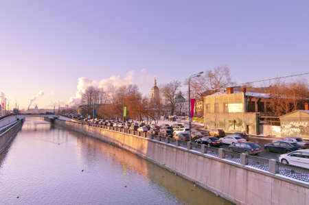 Yauza embankment with one of  Seven sisters   Traditional traffic jam at embankment  Moscow december 2012  photo