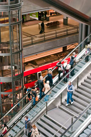u bahn: Main Berlin station interior with moving pasangers and train at low stage  HauptBahnhoff of Berlin, May 2013  Editorial