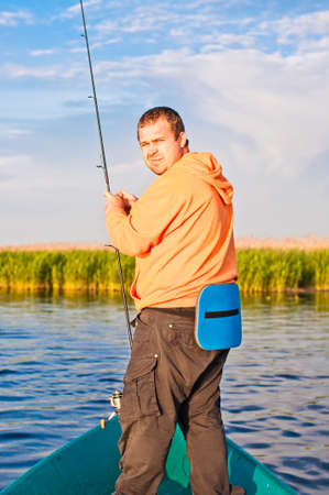 cautious: Fisherman watching back cautious, like a poacher.