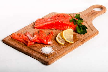limon: Salmon fish on board with salt and lemon