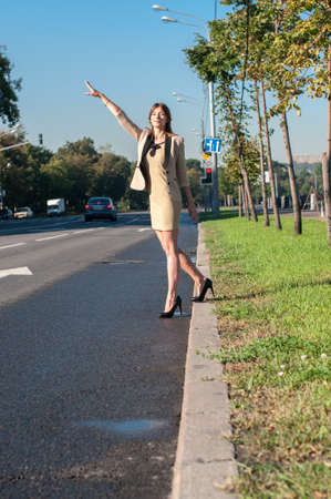 Business woman catches a Taxi in the street of Moscow photo