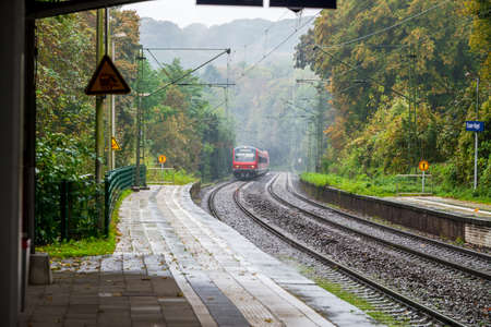 west of germany: Coming train to station in west germany