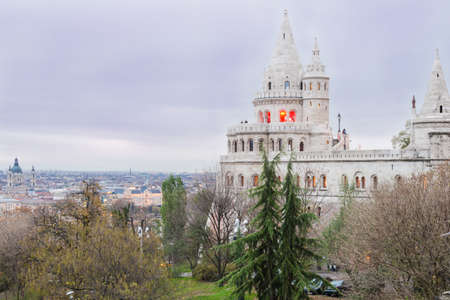 Fisherman bastion with view of Pest. Autumn evening. Stock Photo - 24618922