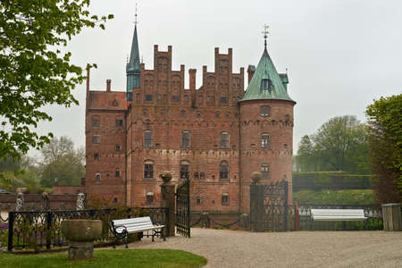 wheather: EGESKOV, DENMARK  - 05 May 2014 View of castle in cloudy wheather on 05 May in Egeskov. Editorial