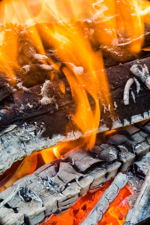 ember: Closeup of flames on an open burning wood fire. Stock Photo