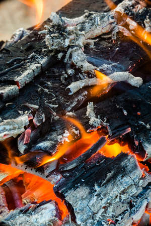 charred: Closeup of flames on an open burning wood fire. Stock Photo