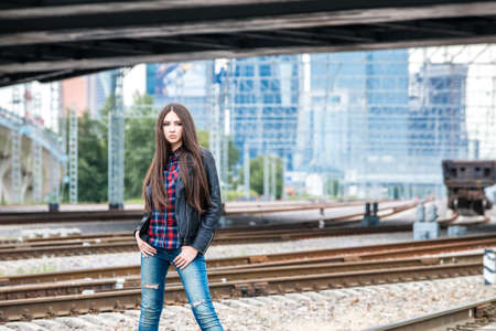 Girl at railroad in Moscow with MIBC in background  photo