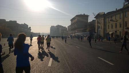 Moscow, Russia - September 21, 2014: Sadovoe Koltzo street with participants of Moscow marathon. Cityrun.