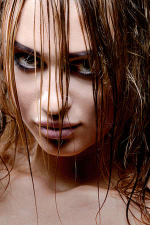 cryptic: Close up portrait of blond woman with wet hair