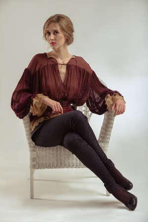 Elegant attractive woman portrait in braun shirt photo