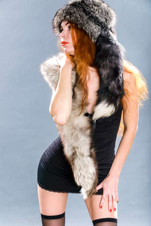 Dance in furs with redhair woman in black lingerie photo