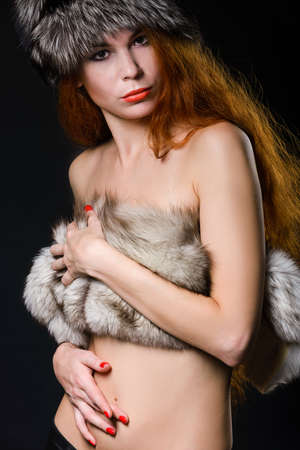 Close up portrait of pretty woman in furs photo