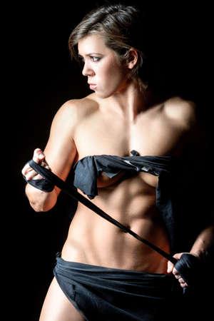 tensed: Powerlifting woman portrait with tensed bind in hands