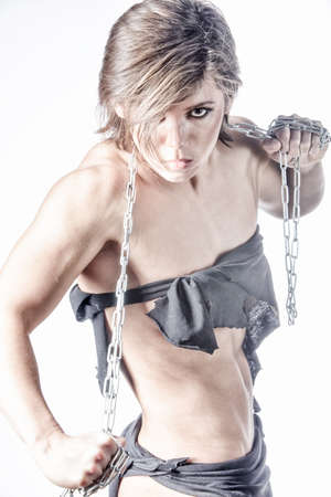 powerfull: Powerfull athletic woman with chain ready to defense Stock Photo