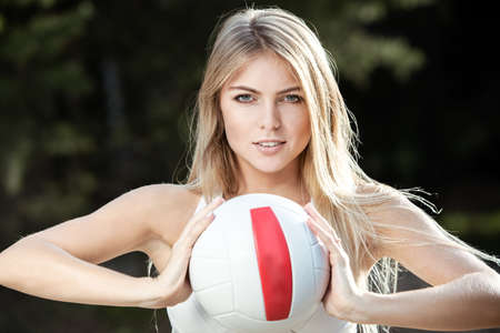 volleyball: Playing a ball. Young cute girl is throwing volley ball