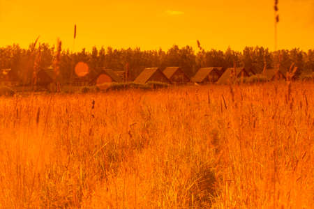 wheather: Agricultural landscape in warm tone with cottage village
