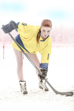 play ground: Girl hockey player on play ground with winter landscape